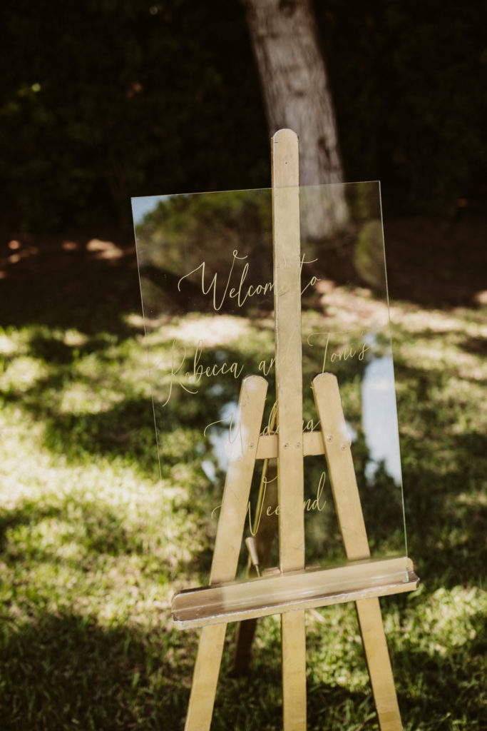 Welcome wedding sign on glass on wooden easle